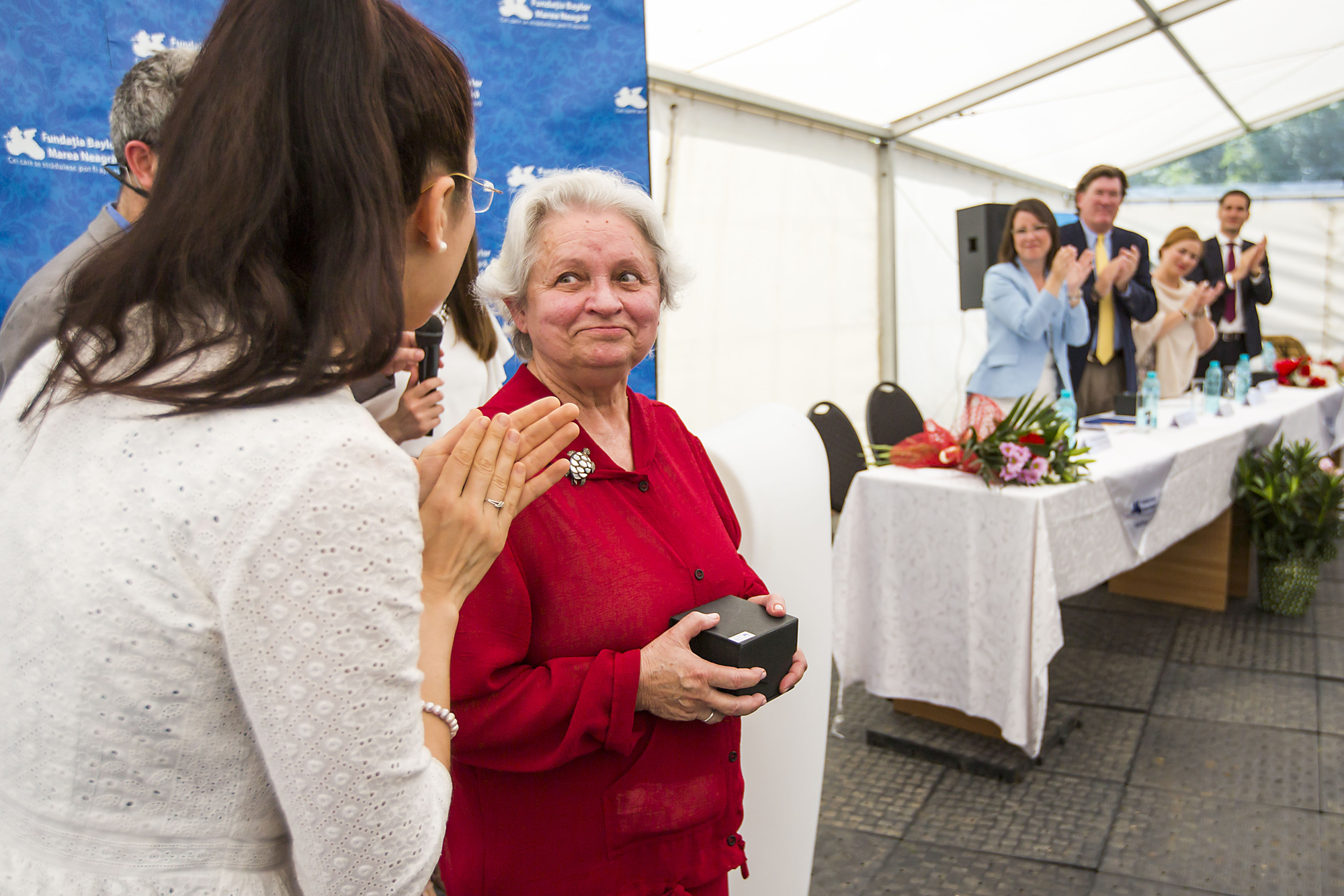 Ana-Maria Schweitzer, Executive Director, Romania, applauds Dr. Rodica Matusa, who receives a standing ovation during a celebration of the opening of the expansion of the Baylor Black Sea Foundation Center of Excellence on Tuesday, June 7, 2016, in Constanta, Romania. ( Photo by  Smiley N. Pool / © 2016  )